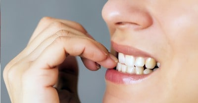 biting your nails is bad for your teeth